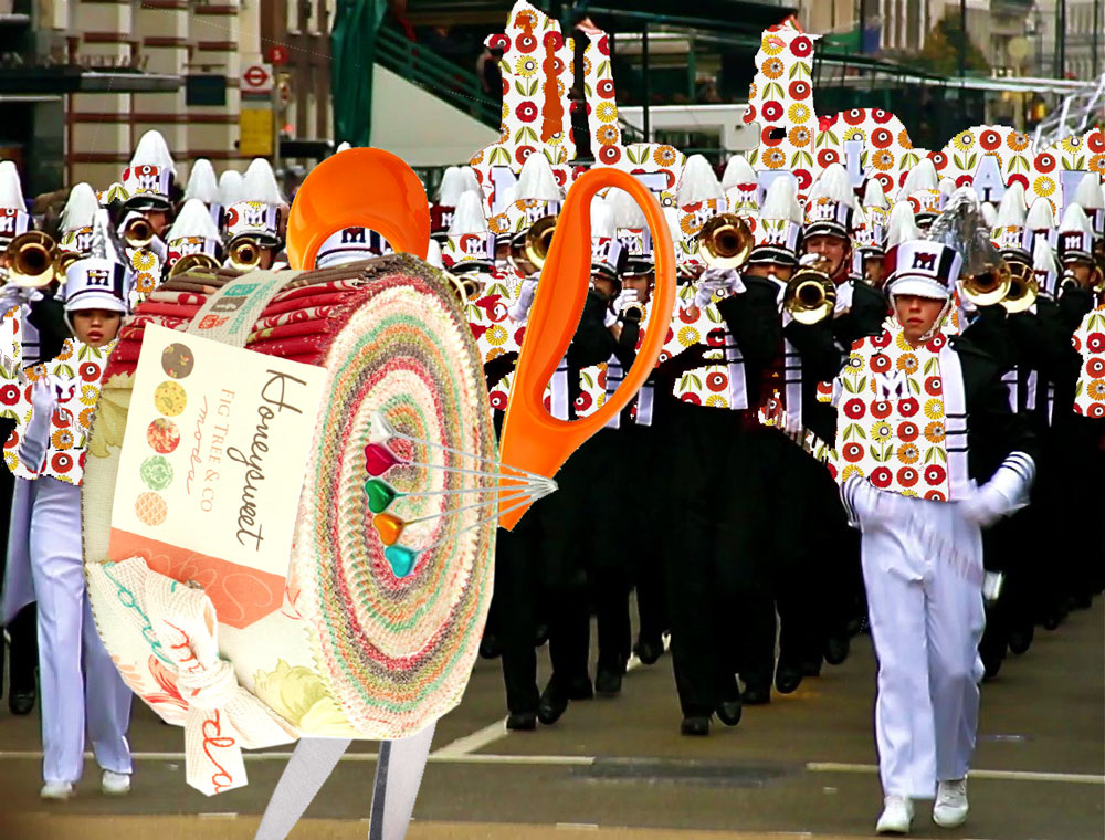 Leading the 2014 New Years Parade is Mr Fiskars and his Jelly Roll Drum.